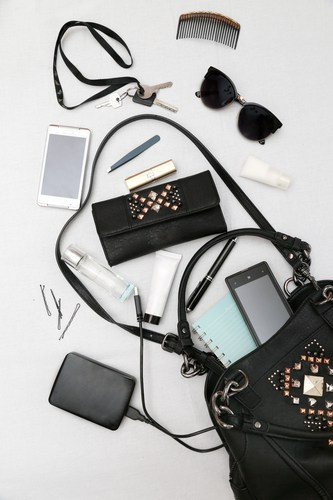 Numerous objects spilling out of purse