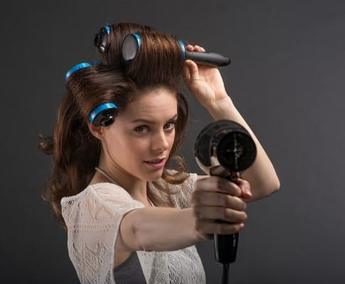 Model point hairdryer with Click n Curl in her hair