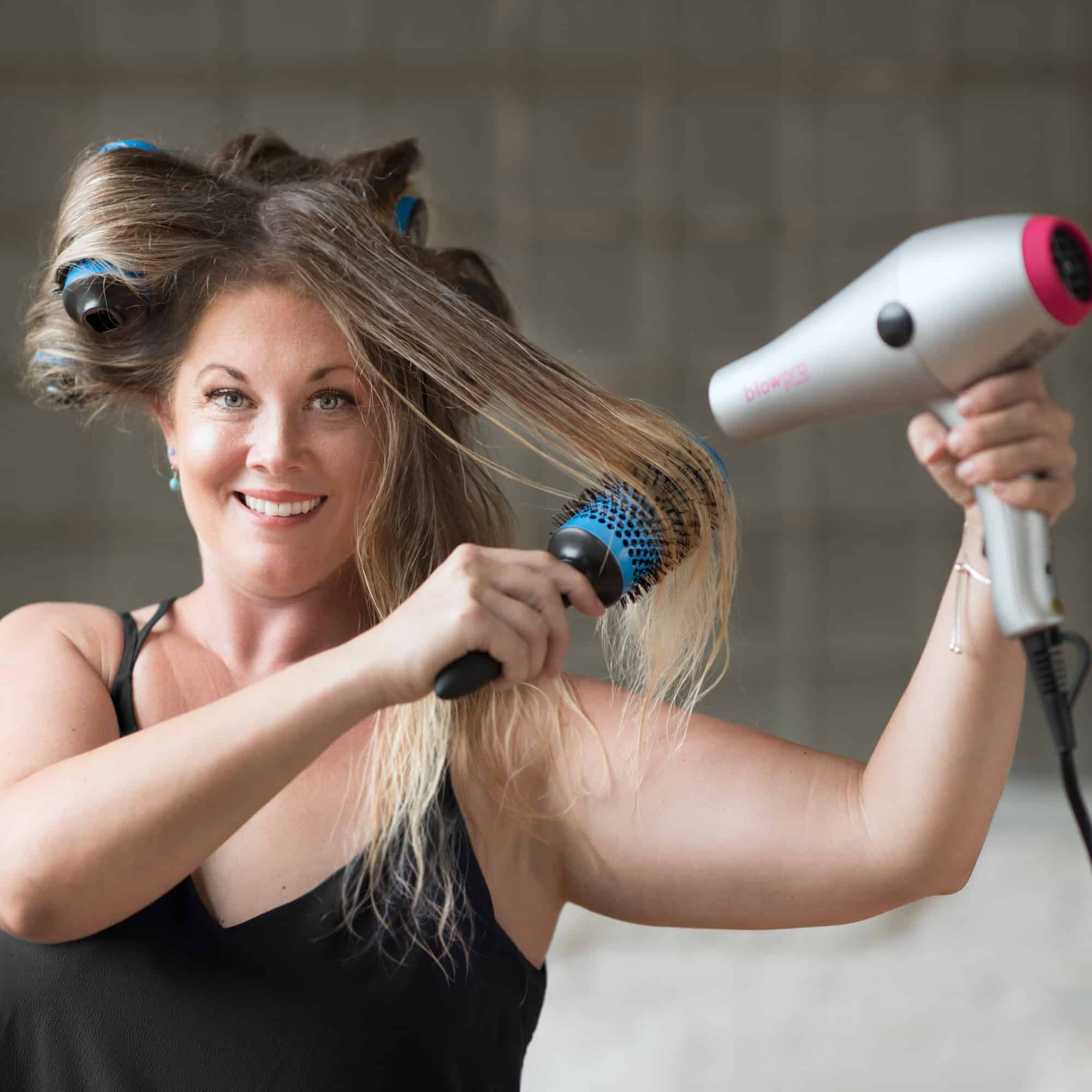 Model using Large Click n Curl Barrels while Hair-drying for an at home DIY Blowout style.