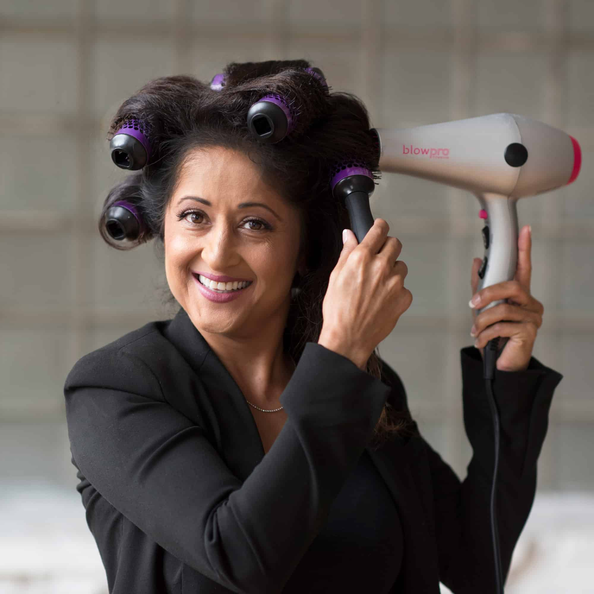 Model using Medium Click n Curl Barrels while Hair-drying for an at home DIY Blowout style.