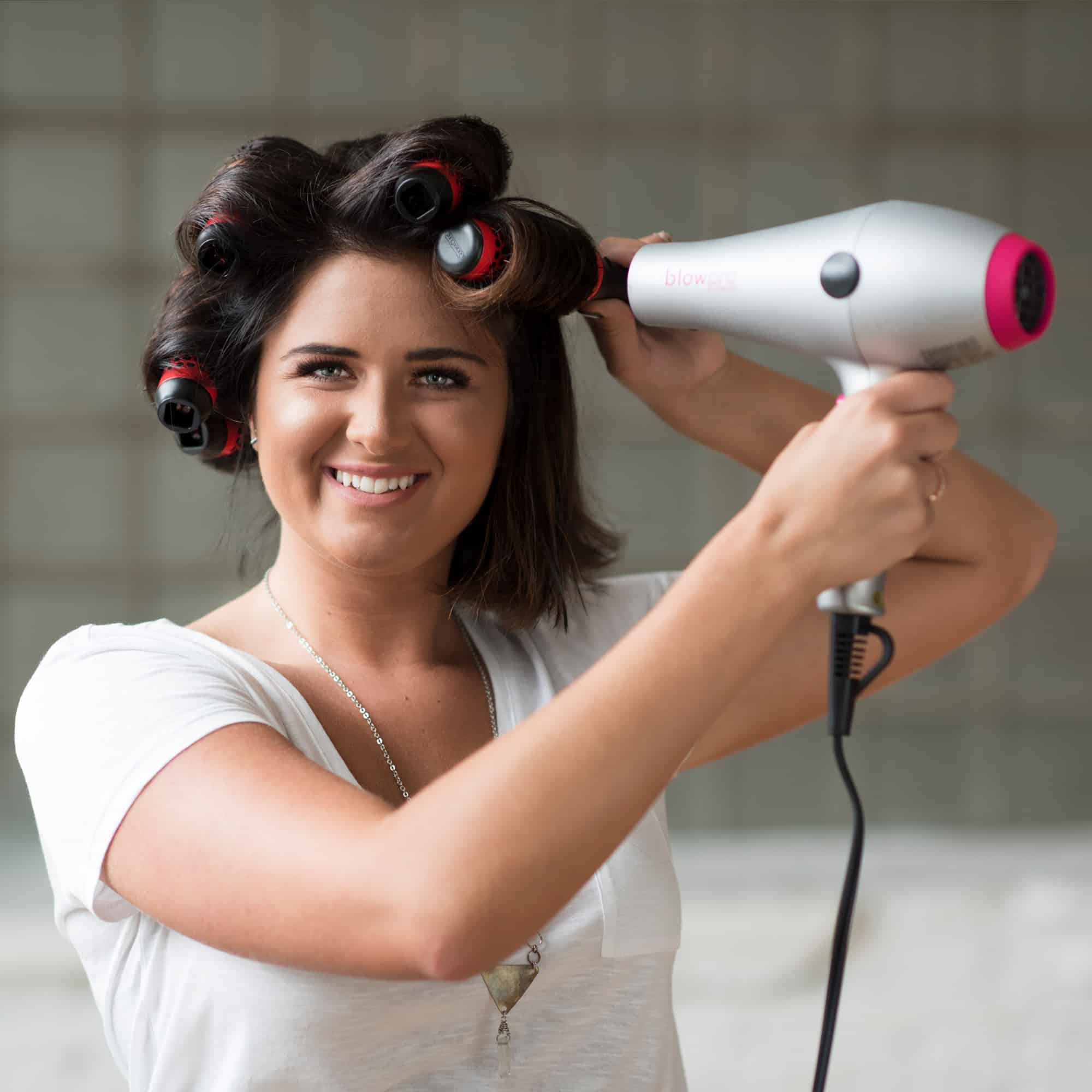 Model using Small Click n Curl Barrels while Hair-drying for an at home DIY Blowout style.