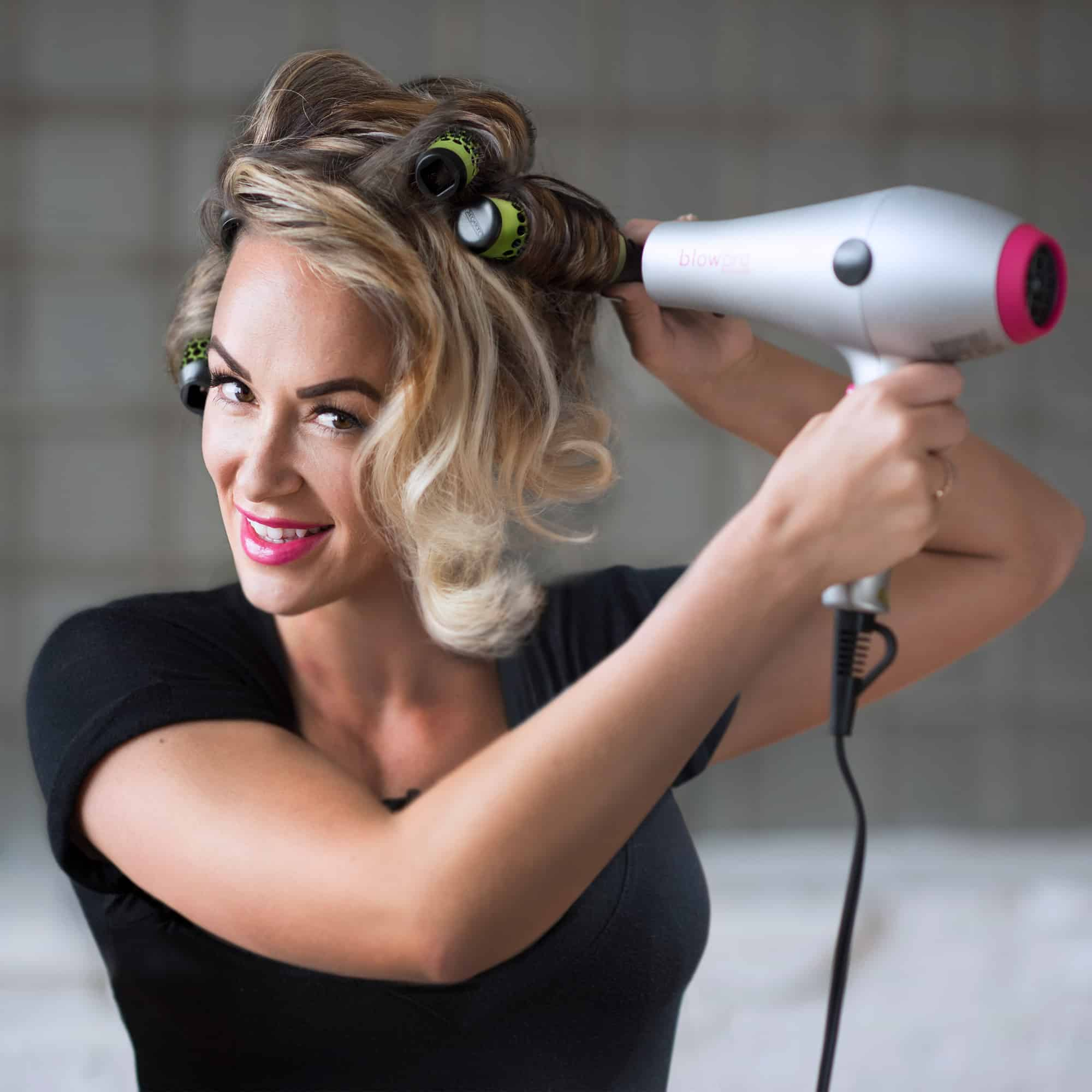 Model using Extra Small Click n Curl Barrels while Hair-drying for an at home DIY Blowout style.